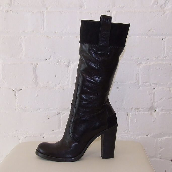Mid-calf leather boots with suede band.
