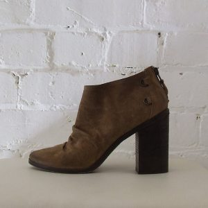 Light brown suede ankle boots, intentional aging.