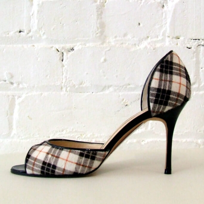 Printed pony peep-toe stiletto with patent leather detail. Look new!