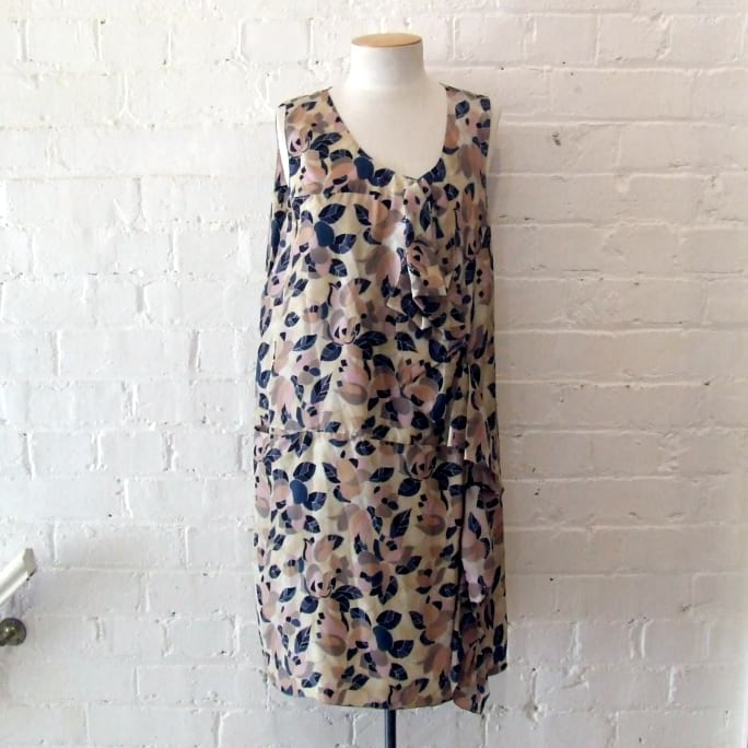 Silk dress with ruffle detail and pocket. Has matching silk underslip.