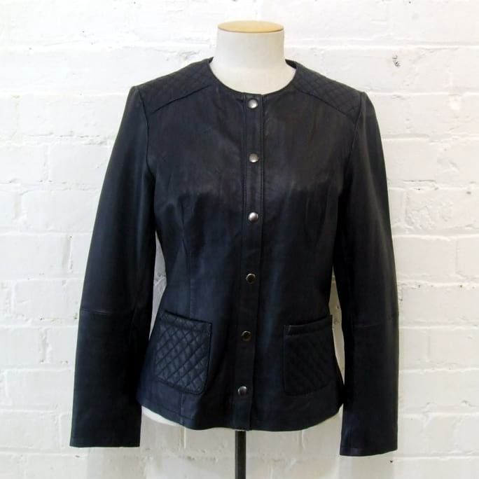 Collarless quilted leather jacket, cotton-lined.