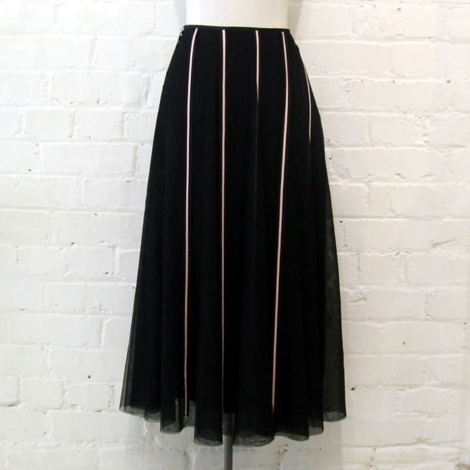 Black tulle skirt with pink ribbon detail, lined.