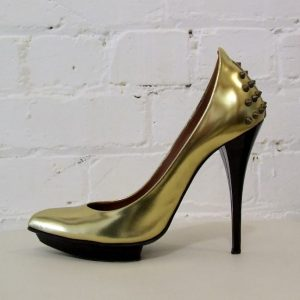 Gold stiletto with studded heel.