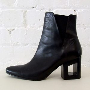 Black leather ankle boot with cut-out heel.