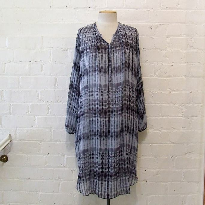 100% silk shirt dress with pockets, tie-dye effect.