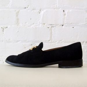 Suede loafer with horse shoe buckle.