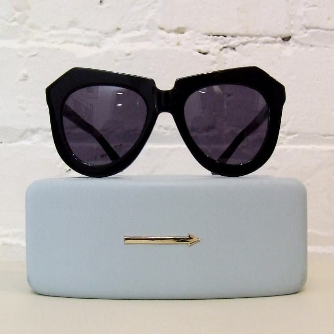 One Worship geometric sunglasses, with hard case.