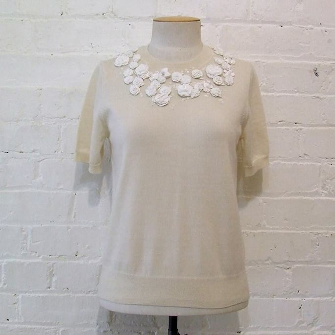 Cream wool short sleeve top with embroidered rosettes and sequins.