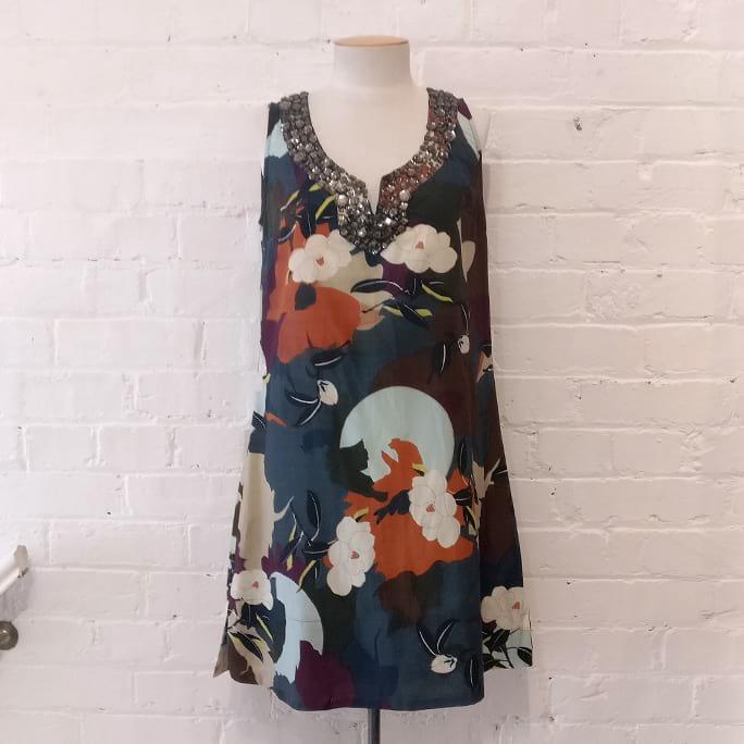 Nature print dress with chunky gem collar.