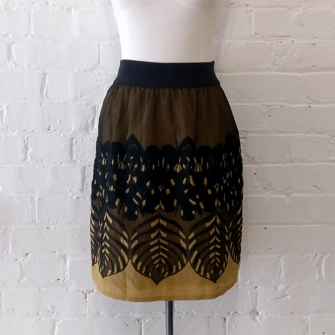 Philosophy skirt with flocking and net detail.