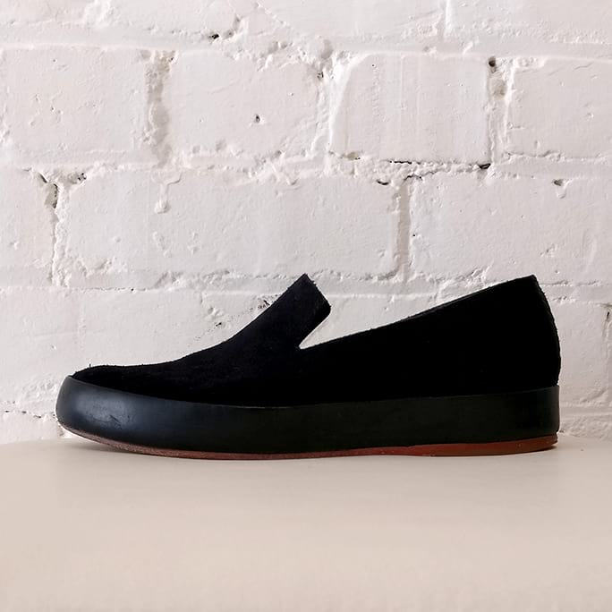 Suede slip-on shoes.