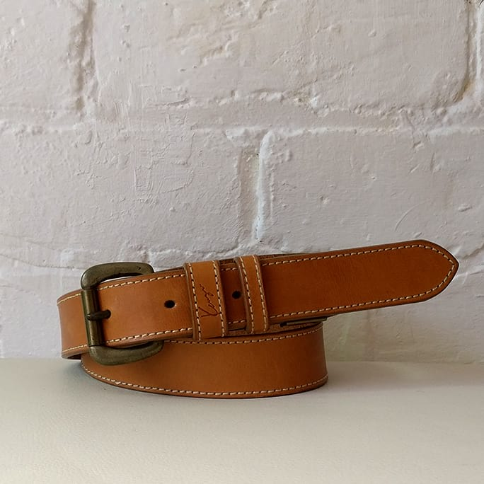 Tan leather belt with brass buckle.
