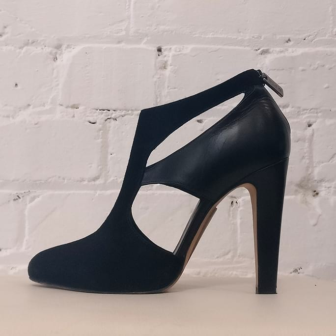 High heel shoe with cut-outs.
