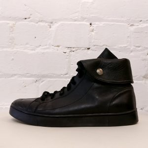 Black leather hi-top sneakers.
