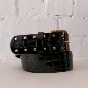 Textured patent leather belt.
