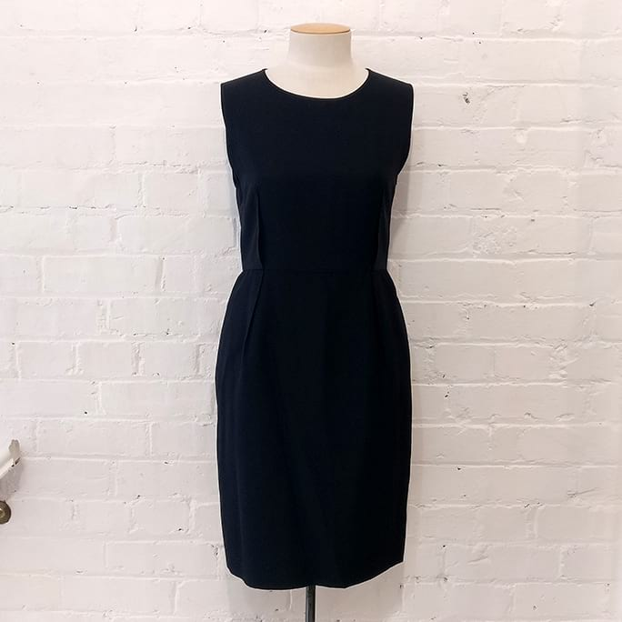 Black sleeveless dress with pockets.