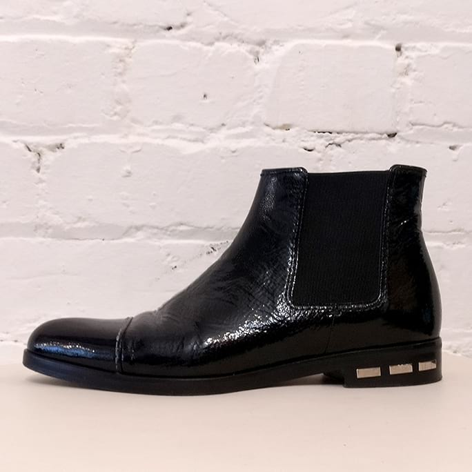 Textured patent leather ankle boots.