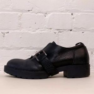 Heavy black leather Muflone shoe with over-buckle, has box.