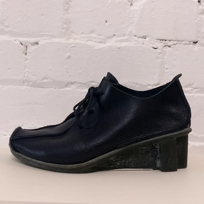 Black leather lace-ups.