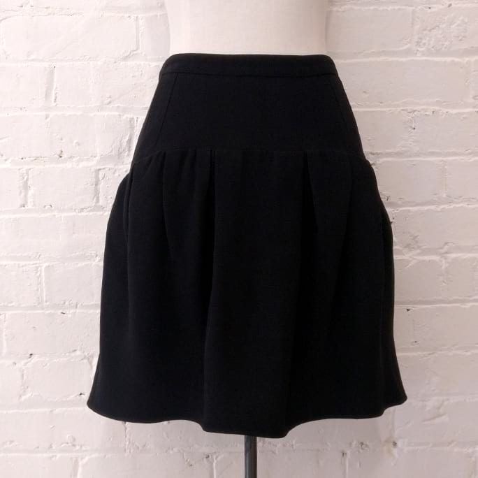Black drop-waist short skirt.