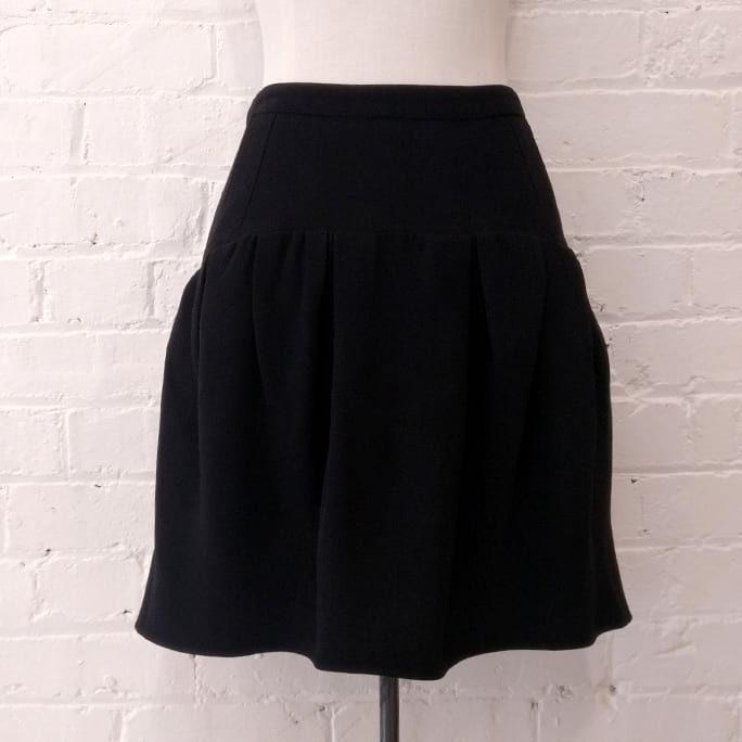 Black drop-waist short skirt.