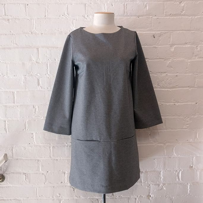 Tunic-style dress with 3/4 sleeves and pockets.