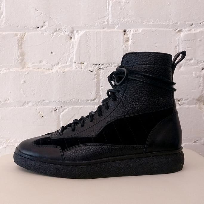 Eden high top sneakers, black leather with suede panels. Has original box.