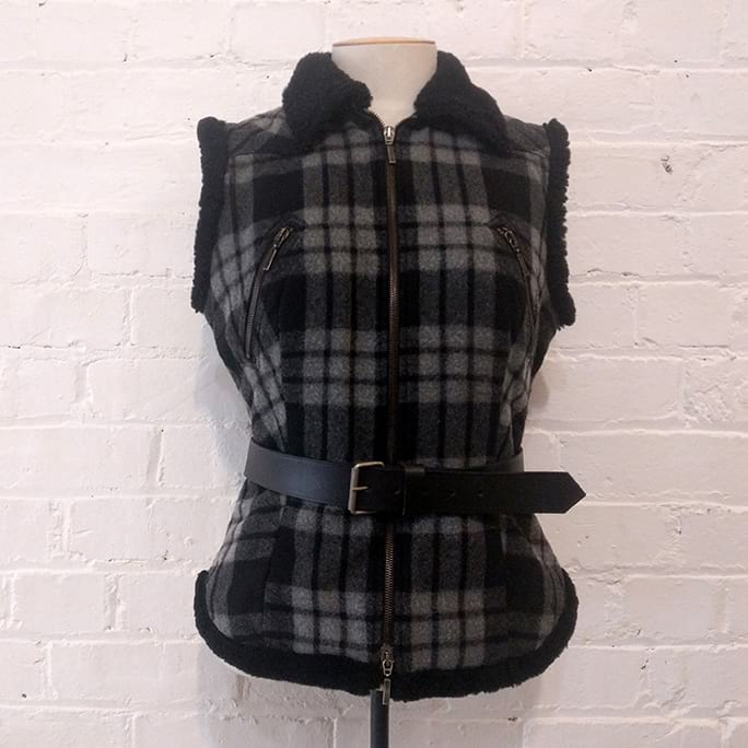 Plaid wool vest, quilted with sheepskin edging. Belt included!