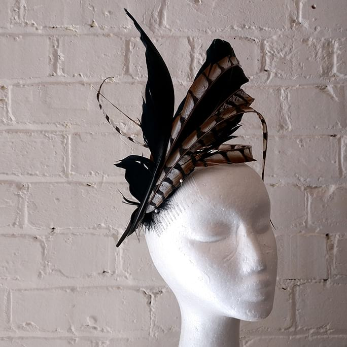 Handmade feather fascinator with hat box.