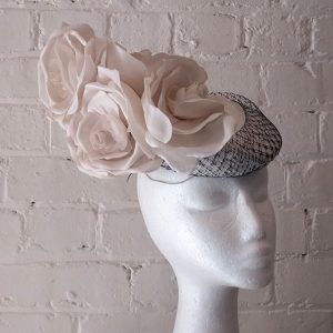 Handmade cream silk hat with roses and hat box.