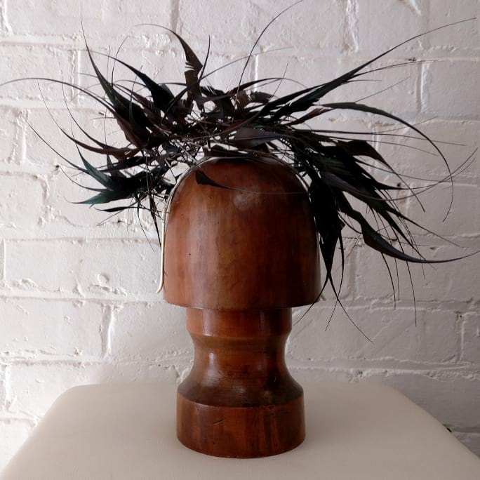 Woven feather headpiece with box.