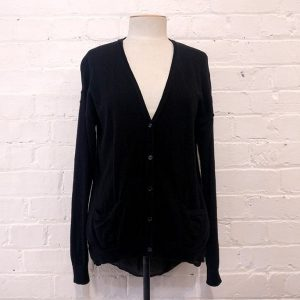 Black cardigan with sheer back, has pockets.