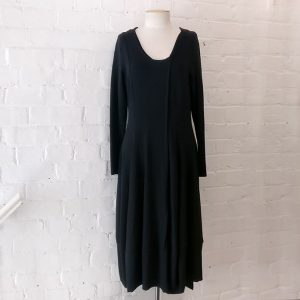 Fitted dress with bell hem.