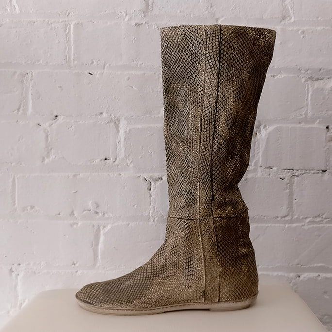 Pull-on snakeskin boots with rubber sole.