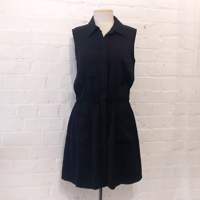 Shirt-style silk dress with patch pockets, lined.