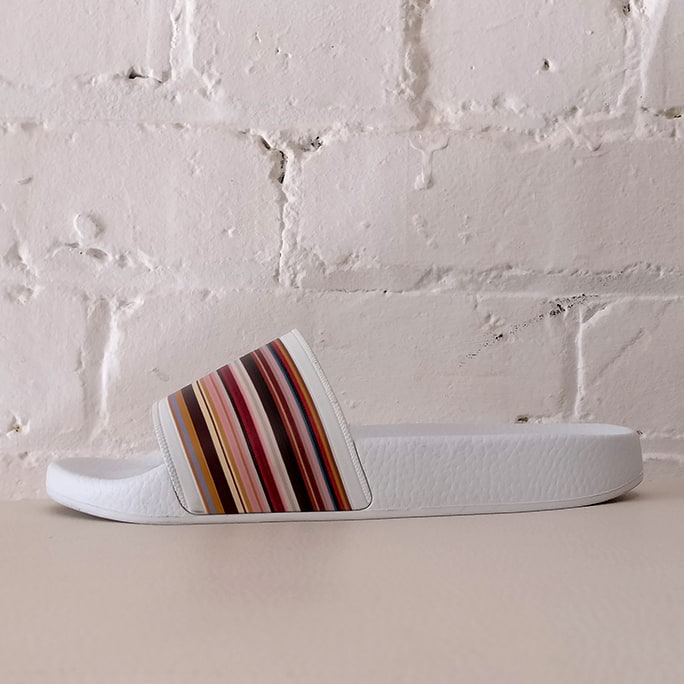 Rubina slides with signature stripes.