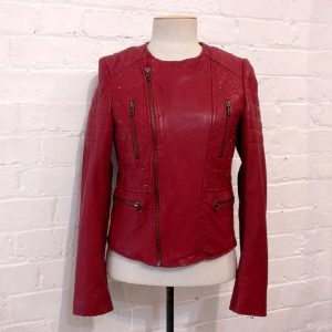 Red leather collarless jacket, lined.