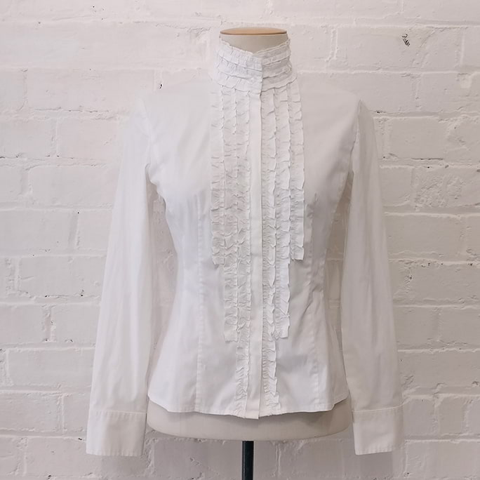 Stretch cotton shirt with ruffle front.