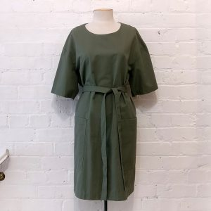 Green cotton dress with patch pockets and belt.