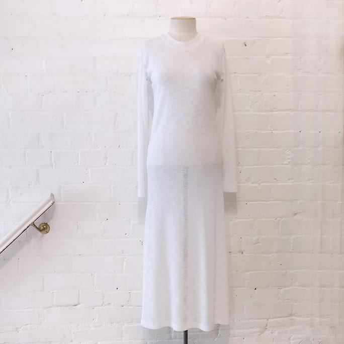 Long sleeve sheer knit dress.