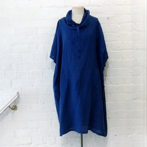 Oversize linen dress with patch pockets and cowl neck.