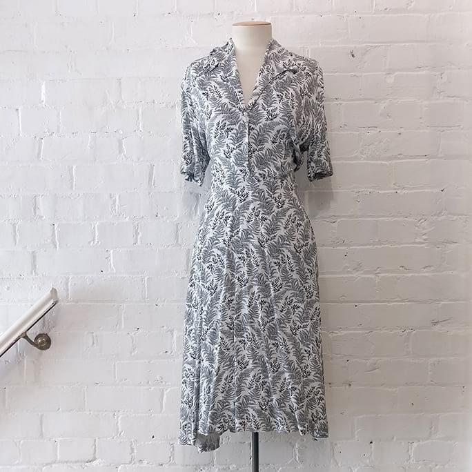 Prim dress with fern print.