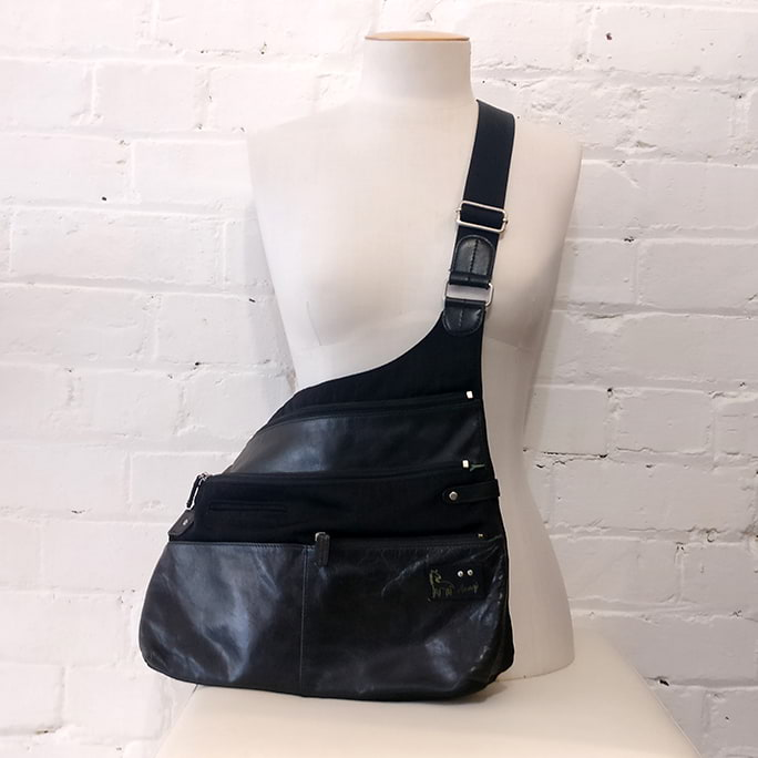 Cross-body leather and canvas bag.