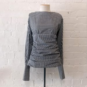 Gingham top with rouched sides.