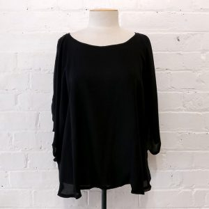 Silk bat-sleeve top with scalloped edge.