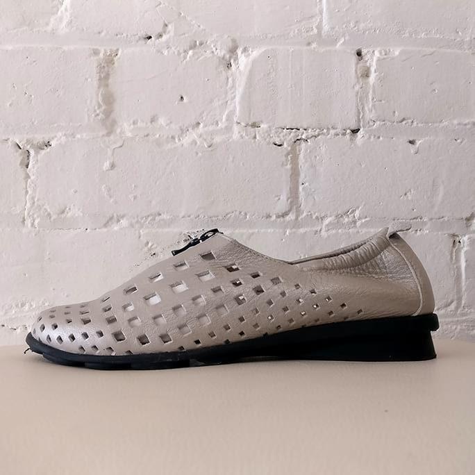 Zip-front sandal with metallic sheen.