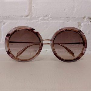 Rose gold sunglasses, unused with case.  Not suitable for prescription lenses.