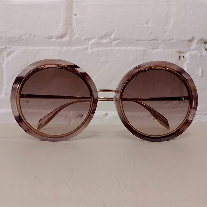 Rose gold sunglasses, unused with case.