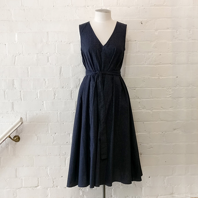 Cotton check flared dress with belt.