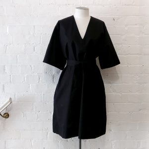 Dress with pockets and belt.